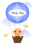 Baby in baloon. Baby flying in a hot air baloon Stock Image