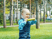 Baby with banana Stock Image