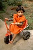 Baby, Bangles and Tricycle Stock Photo
