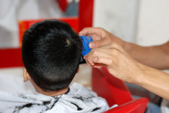 Baby and barber Royalty Free Stock Image