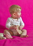 Baby barefoot child wears shoes Stock Image