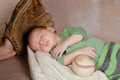 Baby with baseball Stock Photo