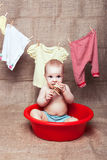 Baby in a basin Stock Image