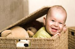 Baby in the basket. A very cute 8-9 months old baby is playing with teddy bears in a basket. This is a full series of 14 photos, take a look at them all before stock images