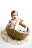 Baby in the basket. A photo of baby inside the basket, isolated Stock Image
