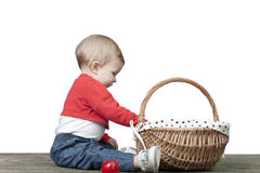 Baby with basket of apples, seated on a old wooden table Stock Images