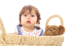 Baby in basket with teddy Royalty Free Stock Image