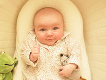 Baby in Bassinet Stock Photo
