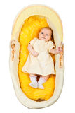 Baby in bassinet, top view Royalty Free Stock Photography
