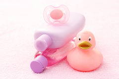 Baby bath. Accessories for baby bath on pink towel - body care royalty free stock photo