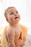 Baby after bath. Beautiful baby girl with towel on white Royalty Free Stock Image