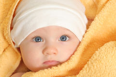 Baby after bath. Baby girl after bath in towel Royalty Free Stock Photo