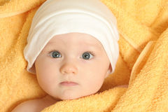 Baby after bath. Baby girl after bath in towel Royalty Free Stock Photos