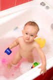 Baby bath. Child is standing on the rubber mat Royalty Free Stock Photo