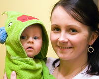 Baby after bath in hood. Mother with her baby in towel hood just after bath stock images