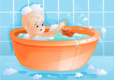 Baby in the bath Stock Image