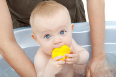 Baby bath ter. Baby playing in a blue bathtub Stock Photography