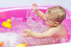 Baby bath time Stock Photos