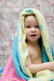 Baby after bath under towel Stock Photography