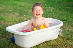 A baby bathed in the bath and playing with toys Royalty Free Stock Images