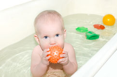 Baby is bathed in light bathroom Royalty Free Stock Photo
