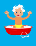Baby bathing in a basin. Royalty Free Stock Images