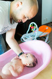 Baby bathing Royalty Free Stock Images