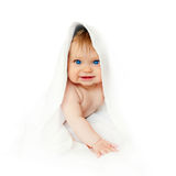 Baby after bathing wrapped in a towel. Baby after bathing in a towel ready for your logo, text or symbols stock photo