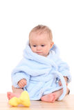 Baby in bathrobe Stock Images