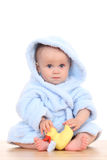 Baby in bathrobe. Little cute baby girl in blue bathrobe isolated on white stock photography