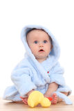 Baby in bathrobe. Little cute baby girl in blue bathrobe isolated on white royalty free stock image