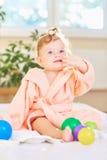 Baby in the bathrobe after the bath. Baby cute in the bathrobe after the bath royalty free stock photos
