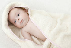 Baby in bathrobe.ter. Baby wearing a hooded bathrobe Stock Image
