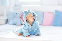 Baby in bathrobe or towel after bath Stock Photos