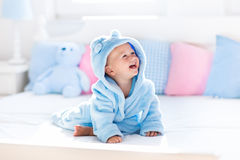 Baby in bathrobe or towel after bath Royalty Free Stock Photos