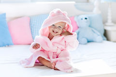 Baby in bathrobe or towel after bath stock images