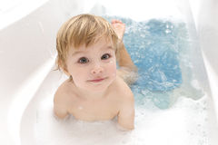 Baby in a bathroom. The child bathes in a bathroom royalty free stock photography