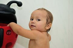 Baby in bathroom. Happy little baby a swimming in the bathroom.Portrait of baby bathing in a bath royalty free stock photos