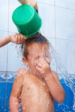 Baby in bathroom pouring water Royalty Free Stock Photos
