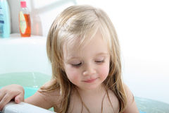 Baby in a bathtub Stock Images