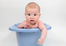 Baby in a bathtub Stock Photo