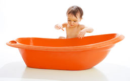 Baby beside bathtub Stock Photos