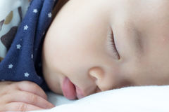 Baby bay sleeping on white bed Royalty Free Stock Photos