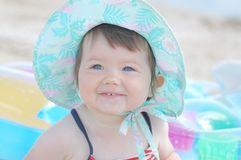 Baby on the beach. Portrait of beautiful baby on matress Stock Images