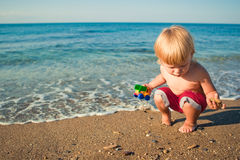 Baby and beach Stock Photo