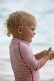 Baby at beach Stock Image