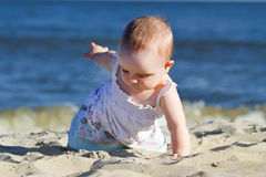 Baby on a beach Royalty Free Stock Photo