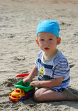 Baby on beach. Sit and play Royalty Free Stock Photo