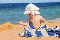 Baby on the beach Stock Photo