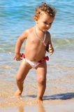 Baby in the beach Stock Photo